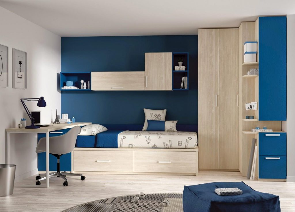 Cool-kids-room-interior-design-with-dark-blue-paint-wall-decor-and-natural-wooden-wardrobe-corner-and-simple-study-table-and-round-rug-on-laminate-floor
